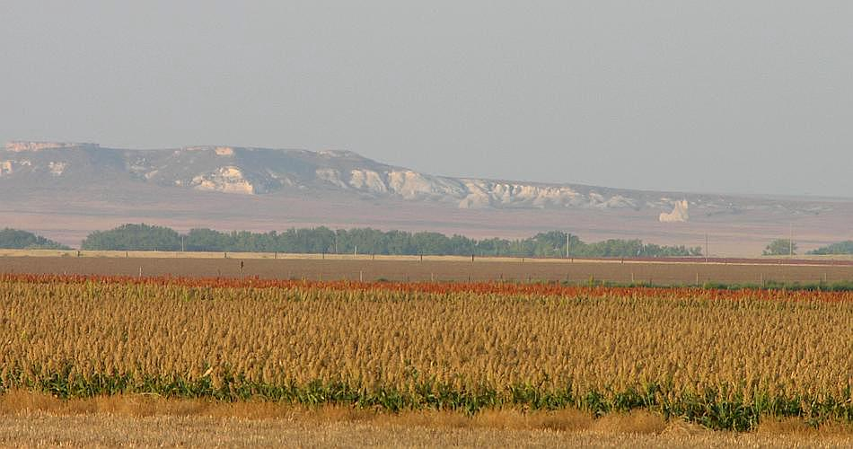 Castle Rock Badlands in distance across fields