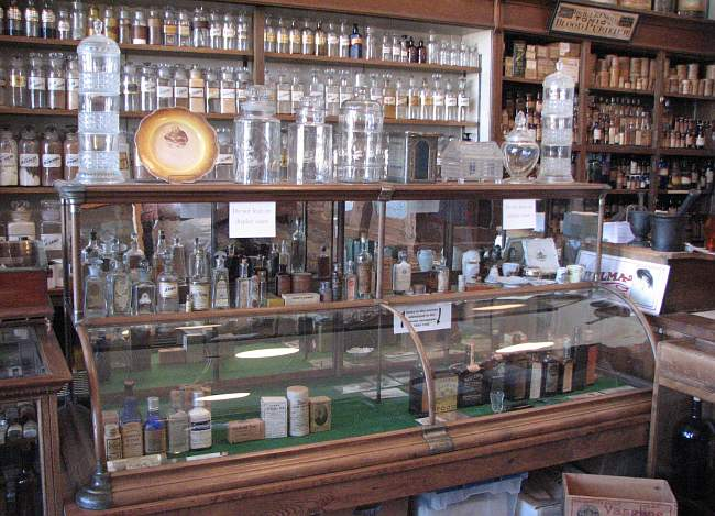 antique medicine bottles, jars and showcase
