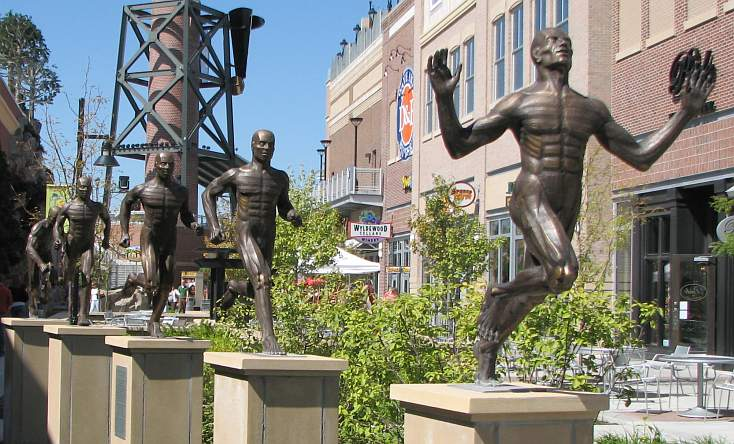 statues dedicated to Glenn Cunningham, Wes Santee and Jim Ryun