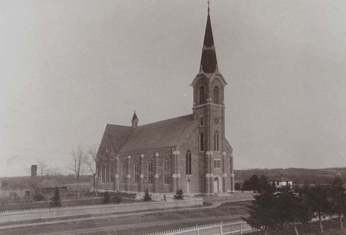 1905 photo of St. Mary's Catholic Church on display at the church enterance