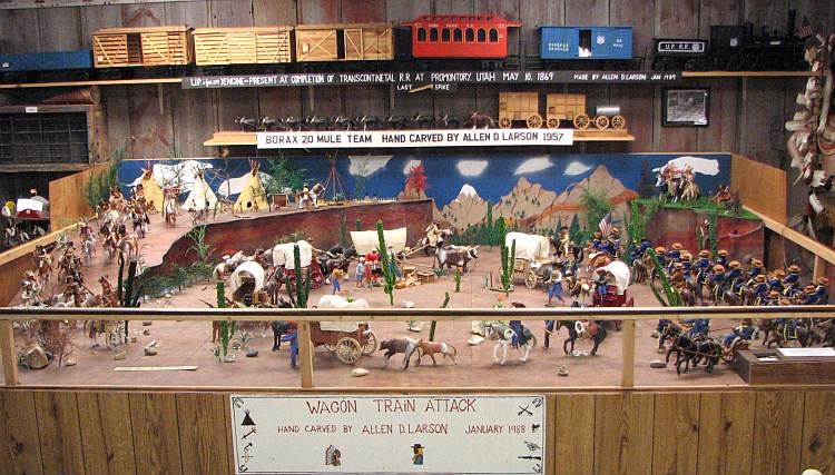 Wagon Train Attack wood carving by Allen D. Larson