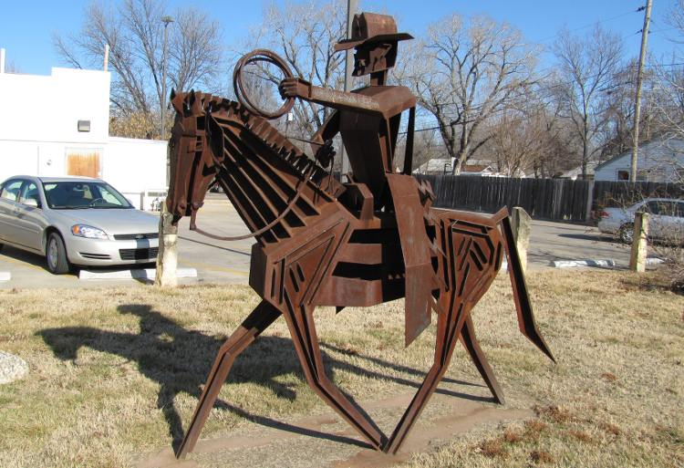 Frank Jensen sculpture of cowboy on horseback