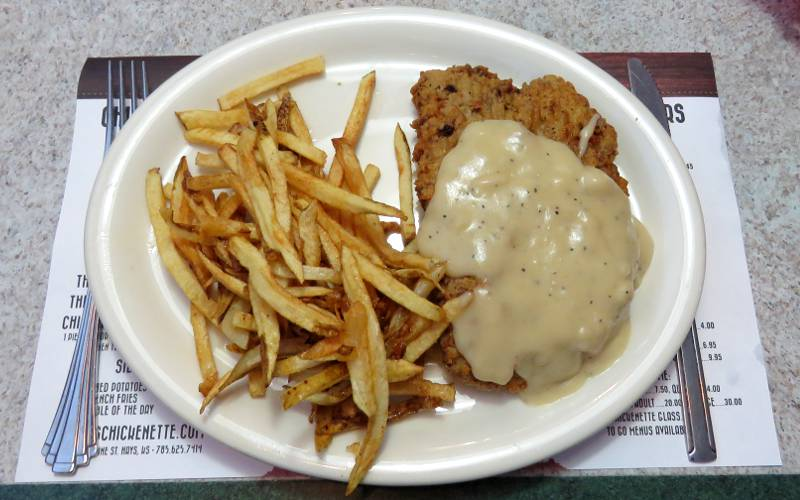 chicken fried steak with mashed potatoes and corn